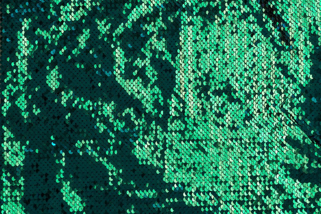 Abstract sequins green glitter wave background texture